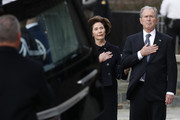 (AFP OUT) Former President George W. Bush and former first lady Laura Bush watch as the flag-draped casket of former President George H.W. Bush is carried by a joint services military honor guard to a State Funeral at the National Cathedral December 5, 2018 in Washington, DC. President Bush will be buried at his final resting place at the George H.W. Bush Presidential Library at Texas A&M University in College Station, Texas. A WWII combat veteran, Bush served as a member of Congress from Texas, ambassador to the United Nations, director of the CIA, vice president and 41st president of the United States.