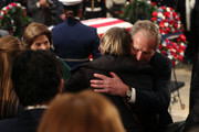 Former U.S. President George W. Bush and his wife Laura Bush greet mourners in front of the casket of the late former President George H.W. Bush as he lies in state in the U.S. Capitol Rotunda, December 4, 2018 in Washington, DC. A WWII combat veteran, Bush served as a member of Congress from Texas, ambassador to the United Nations, director of the CIA, vice president and 41st president of the United States. Bush will lie in state in the U.S. Capitol Rotunda until Wednesday morning.