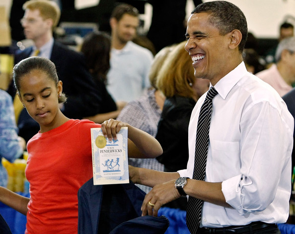 "( AFP OUT) U.S. President Barack Obama (R) and his daughter Malia (L) help volunteers and members of Congress stuff backpacks with books, food and photographs of the first dog Bo during a United We Serve event at Fort McNair June 25, 2009 in Washington, DC. Helping to fill 10,000 backpacks for children of military servicemen and women, the first family stuffed copies of ""The Lightning Thief,"" by Rick Riordan, and ""The Penderwicks,"" by Jeanne Birdsall into backpacks along with food items and a personal letter from the president and the first lady."