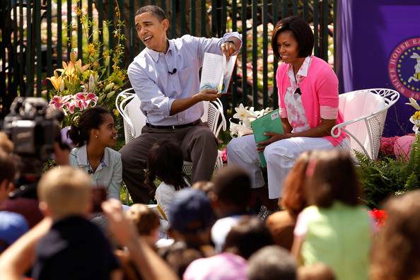 "U.S. President Barack Obama (C) reads ""Green Eggs and Ham,"" by Dr. Suess, for a group of children and his family, first lady Michelle Obama (R) and daughters Malia Obama (L), 11, and Sasha Obama, 8, during the Easter Egg Roll at the White House April 5, 2010 in Washington, DC.  About 30,000 people are expected to attend attended the 132-year-old tradition of rolling colored eggs down the South Lawn of the White House."