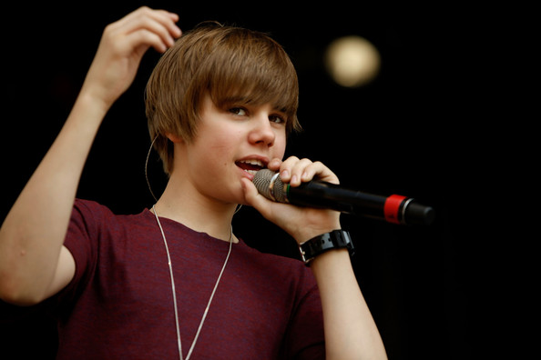 Canadian pop star Justin Bieber performs during the Easter Egg Roll on the South Lawn of the White House April 5, 2010 in Washington, DC. About 30,000 people are expected to attend attended the 132-year-old tradition of rolling colored eggs down the South Lawn of the White House.