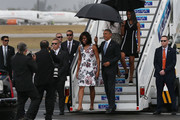President Barack Obama, Michelle Obama and Sasha Obama (R) walk down the stairs as they arrive at Jose Marti International Airport on Airforce One for a 48-hour visit on March 20, 2016 in Havana, Cuba. Mr. Obama's visit is the first in nearly 90 years for a sitting president, the last one being Calvin Coolidge.