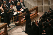 U.S. President Barack Obama wipes a tear while he and first lady Michelle Obama (C), Dr. Jill Biden (2nd-R) and Vice President Joseph Biden (R), listen to Michele Fowlin (L) direct the Children of the Gospel Choir during the National Prayer Service at the National Cathedral, on January 22, 2013 in Washington, DC. President Obama was sworn in on January 20 for his second term as President of the United States.