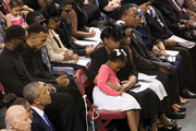 The family of Sen. Clementa Pinckney (top center) sits in the front row along with U.S. President Barack Obama, First Lady Michelle Obama, Vice President Joe Biden and Dr. Jill Biden (bottom) during the funeral service for Sen. Clementa Pinckney at the College Charleston TD Arena for South Carolina State Sen. Clementa Pinckney who was killed during the mass shooting at the Emanuel African Methodist Episcopal Church along with eight others on June 26, 2015 in Charleston, South Carolina. Suspected shooter Dylann Roof, 21 years old, is accused of killing nine people on June 17th during a prayer meeting in the church, which is one of the nation's oldest black churches in Charleston.