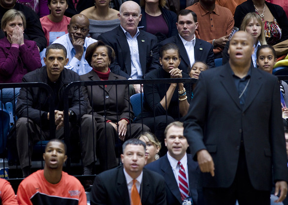 Craig Robinson (AFP OUT) U.S. President Barack Obama watches along with his mother in law Marian Robinson (2L) wife first lady Michelle Obama (3L) daughter Sasha Obama (3R), brother in law Craig Robinson (2R) and daughter Malia Obama (R) during a college basketball game at George Washington University November 28, 2009 in Washington, DC.  President Barack Obama attended the game between George Washington University and Oregon State, which is coached by his brother in law Craig Robinson.