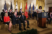 U.S. first lady Michelle Obama (R) speaks as President Barack Obama (3rd L), Vice President Joseph Biden (2nd L), and Biden's wife Jill Biden (L) listen during a veterans employment event in the East Room April 30, 2013 at the White House in Washington, DC. Michelle Obama  and Jill Biden encousrged the private sector to step up the hiring of veterans.