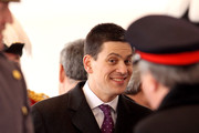 David Miliband smiles during a ceremonial welcome for South Africa President Jacob Zuma on Horseguards Parade on March 3, 2010 in London, England. The South African Leader is on a three day State visit to Britain.