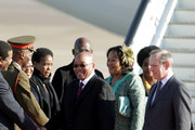 South African President Jacob Zuma (c) and Thobeka Madiba Zuma (second right), his newest of three wives, arrive at Heathrow airport on March 2, 2010 in London, England. Mr Zuma and his wife are beginning a three-day state visit to the UK during which they are due to meet the Queen at Buckingham Palace and visit the Olympic Park site.