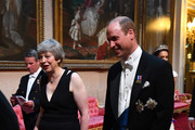 British Prime Minister Theresa May and Prince William, Duke of Cambridge arrive through the East Gallery for a State Banquet at Buckingham Palace on June 3, 2019 in London, England. President Trump's three-day state visit will include lunch with the Queen, and a State Banquet at Buckingham Palace, as well as business meetings with the Prime Minister and the Duke of York, before travelling to Portsmouth to mark the 75th anniversary of the D-Day landings.