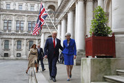 Britain's Prime Minister Theresa May and President Donald Trump walk through the Quadrangle of the Foreign Office for a joint press conference, followed by First Lady Melania Trump and Philip May in central London on the second day of the U.S. President and First Lady's three-day State visit on June 4, 2019 in London, England. President Trump's three-day state visit began with lunch with the Queen, followed by a State Banquet at Buckingham Palace, whilst today he will attend business meetings with the Prime Minister and the Duke of York, before travelling to Portsmouth to mark the 75th anniversary of the D-Day landings.