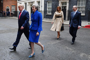 US President Donald Trump, Prime Minister Theresa May, her  husband Philip May and First Lady Melania Trump leave 10 Downing Street, during the second day of his State Visit on June 4, 2019 in London, England. President Trump's three-day state visit began with lunch with the Queen, followed by a State Banquet at Buckingham Palace, whilst today he will attend business meetings with the Prime Minister and the Duke of York, before travelling to Portsmouth to mark the 75th anniversary of the D-Day landings.