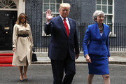 Alternative crop of image #1147933623) Melania Trump, US President Donald Trump and Prime Minister Theresa May leave 10 Downing Street for the Foreign and Commonwealth Office during the second day of his State Visit on June 4, 2019 in London, England.. President Trump's three-day state visit began with lunch with the Queen, followed by a State Banquet at Buckingham Palace, whilst today he will attend business meetings with the Prime Minister and the Duke of York, before travelling to Portsmouth to mark the 75th anniversary of the D-Day landings.