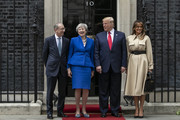 (L-R) Philip May, British Prime Minister Theresa May, U.S. President Donald Trump and First Lady Melania Trump arrive at 10 Downing street for a meeting on the second day of the U.S. President and First Lady's three-day State visit on June 4, 2019 in London, England. President Trump's three-day state visit began with lunch with the Queen, followed by a State Banquet at Buckingham Palace, whilst today he will attend business meetings with the Prime Minister and the Duke of York, before travelling to Portsmouth to mark the 75th anniversary of the D-Day landings.
