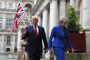 Britain's Prime Minister Theresa May and President Donald Trump walk through the Quadrangle of the Foreign Office for a joint press conference in central London on the second day of the U.S. President and First Lady's three-day State visit on June 4, 2019 in London, England. President Trump's three-day state visit began with lunch with the Queen, followed by a State Banquet at Buckingham Palace, whilst today he will attend business meetings with the Prime Minister and the Duke of York, before travelling to Portsmouth to mark the 75th anniversary of the D-Day landings.