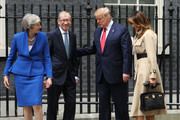 (L-R) British Prime Minister Theresa May, Philip May, US President Donald Trump and First Lady Melania Trump arrive at 10 Downing street for a meeting on the second day of the U.S. President and First Lady's three-day State visit on June 4, 2019 in London, England. President Trump's three-day state visit began with lunch with the Queen, followed by a State Banquet at Buckingham Palace, whilst today he will attend business meetings with the Prime Minister and the Duke of York, before travelling to Portsmouth to mark the 75th anniversary of the D-Day landings.