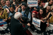 Supporters of Democratic presidential candidate Sen. Bernie Sanders (I-VT) shake hands with the candidate at a rally at the University of Minnesotas Williams Arena on November, 3, 2019 in Minneapolis, Minnesota. Sanders was joined at the rally by Democratic Representative Ilhan Omar, who praised the Senator's policy proposals of comprehensive immigration reform and support for unions.