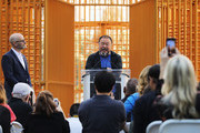"Chinese activist and artist Ai Weiwei speaks in front of one of his new art installations in Central Park, part of a series of works entitled ""Good Fences Make Good Neighbors"" on October 10, 2017 in New York City. Covering over 300 sites in New York City,  ""Good Fences Make Good Neighbors"" seeks to highlight and start a discussion on the global refugee crisis. The works can be viewed through February 11 in a variety of locations including city parks, bus shelters, newsstands and rooftops."