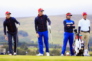 (L-R) Zach Johnson, Webb Simpson, Bubba Watson and caddie Ted Scott of the United States look on during practice ahead of the 2014 Ryder Cup on the PGA Centenary course at the Gleneagles Hotel on September 25, 2014 in Auchterarder, Scotland.