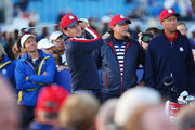 Keegan Bradley of the United States tees off on the 11th hole watched by Phil Mickelson of the United States during practice ahead of the 2014 Ryder Cup on the PGA Centenary course at the Gleneagles Hotel on September 24, 2014 in Auchterarder, Scotland.