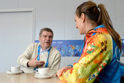 President of the International Olympic Committee Thomas Bach (L) meets with Olympic gold medalist pole vaulter Yelena Isinbayeva of Russia prior to the Sochi 2014 Winter Olympics at the Olympic Village on February 1, 2014 in Sochi, Russia.
