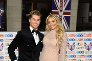(L-R) AJ Pritchard and Saffron Barker attend Pride Of Britain Awards 2019 at The Grosvenor House Hotel on October 28, 2019 in London, England.