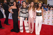 Jesy Nelson, Perrie Edwards, Jade Thirlwall and Leigh-Anne Pinnock from Little Mix attend the Pride of Britain awards at The Grosvenor House Hotel on September 28, 2015 in London, England.