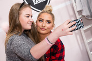 Saffron Barker (R) meets fans as Primark launches exclusive Saffy B by Saffron Barker collection on October 23, 2017 in London, England.