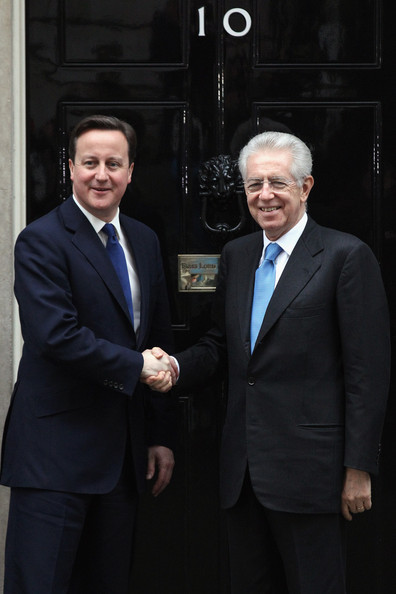 Prime Minister David Cameron (L) greets Italian Prime Minister Mario Monti outside Number 10 Downing Street on January 18, 2012 in London, England. In addition to meeting Mr Cameron on his visit to the UK, Mr Monti will also conduct meetings with financiers to find solutions to tackle Italy's large government debt.