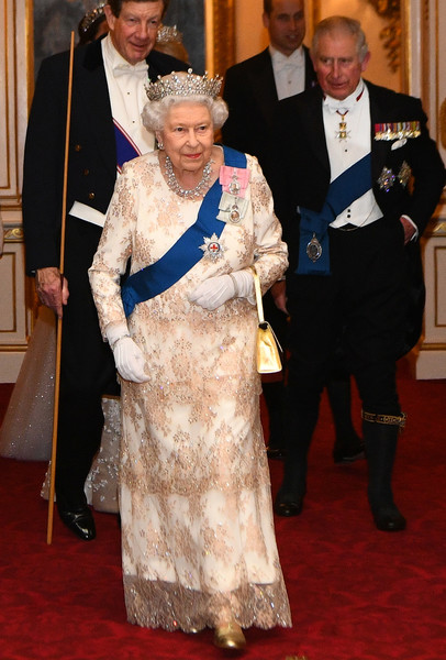 The Duke And Duchess Of Cambridge Attend Evening Reception For Members Of The Diplomatic Corps [flooring,carpet,senior citizen,formal wear,tradition,red carpet,ceremony,fun,costume,event,members,charles,elizabeth ii,military personnel,guests,wales,diplomatic corps,the duke duchess of cambridge,reception,reception]