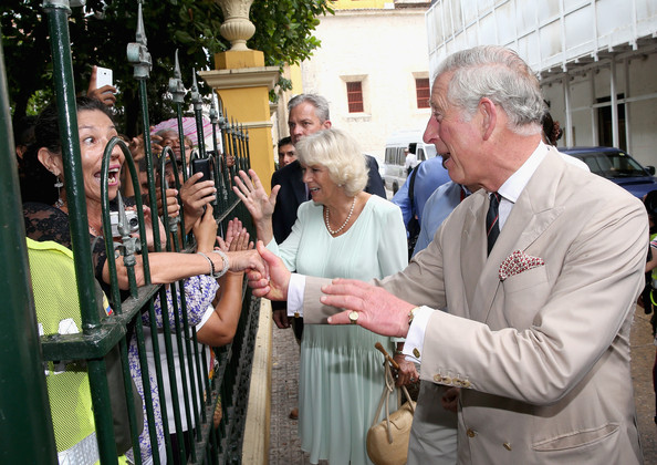 Camilla, Duchess of Cornwall and Prince Charles, Prince of Wales meet members of the public during a visit to the Museo del Oro Zenu on October 31, 2014 in Cartagena, Colombia. The Royal Couple are on a four day visit to Colombia as part of a Royal tour to Colombia and Mexico. After fifty years of armed conflict in Colombia the theme for the visit is Peace and Reconciliation.