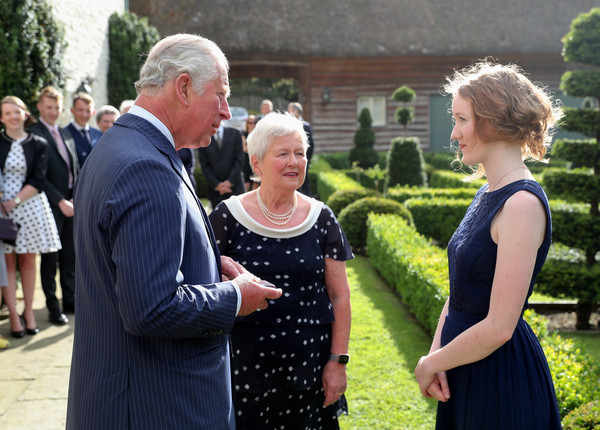 The Prince Of Wales And Duchess Of Cornwall Visit Wales [event,ceremony,wedding,dress,formal wear,gesture,family,charles,alis huws,elinor bennett,royal harpist,brooch,duchess of cornwall,welsh,prince of wales,visit wales,prince of wales]