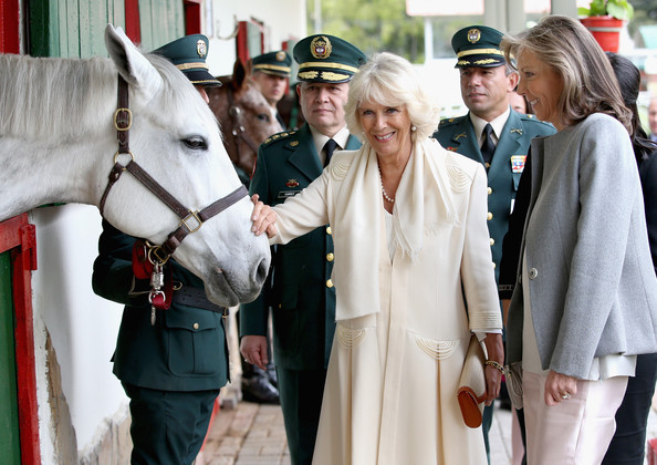 Camilla, Duchess of Cornwall and  First Lady of Colombia Maria Clemencia Rodriguez Munera meets horses as they visits Escuela de Cabelleria del Ejercito (Military Academy) on October 30, 2014 in Bogota, Colombia. The Royal Couple are on a four day visit to Colombia as part of a Royal tour to Colombia and Mexico. After fifty years of armed conflict in Colombia the theme for the visit is Peace and Reconciliation.