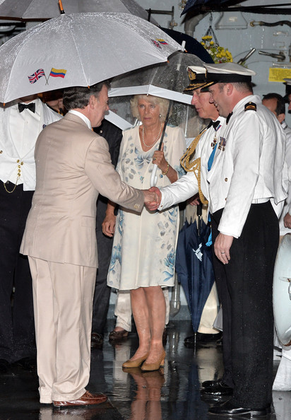 The Prince of Wales and the Duchess of Cornwall greet President of Colombia Juan Manuel Santos at a Sunset Ceremony and Reception on board HMS Argyll on Day 4 of their visit on October 31, 2014 in Cartagena, Colombia. Prince Charles, Prince Of Wales and Camilla, Duchess Of Cornwall are on a four day visit to Colombia as part of a Royal tour to Colombia and Mexico. After fifty years of armed conflict in Colombia the theme for the visit is Peace and Reconciliation.