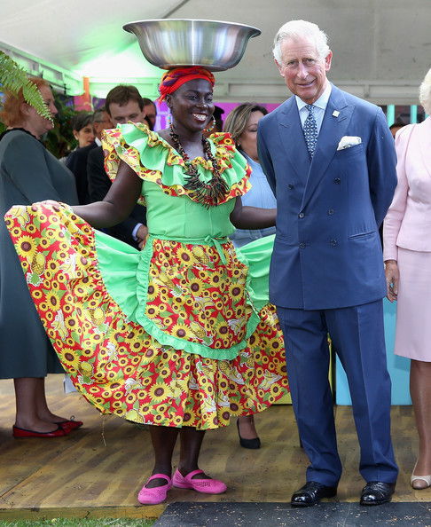 Prince Charles, Prince of Wales meets Carribbean Themed guests at a Sustainability Fair at the Ambassador's Residence on October 29, 2014 in Bogota, Colombia. The Royal Couple are on a four day visit to Colombia as part of a Royal tour to Colombia and Mexico. After fifty years of armed conflict in Colombia the theme for the visit is Peace and Reconciliation.