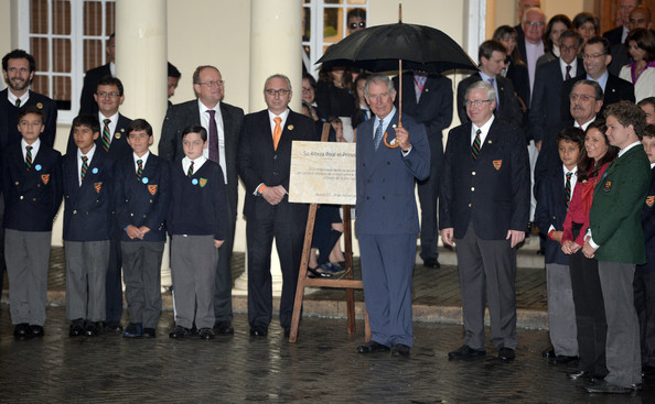Prince Charles, Prince of Wales, Vice Royal Patron, unveils a plaque during a celebration marking the 75th Anniversary of the British Council in Colombia at Gimnasio Moderno School, on October 29, 2014 in Bogota, Colombia. The Royal Couple are on a four day visit to Colombia as part of a Royal tour to Colombia and Mexico. After fifty years of armed conflict in Colombia the theme for the visit is Peace and Reconciliation.
