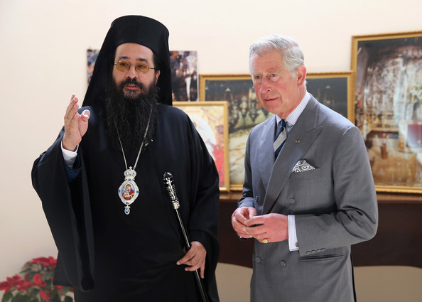 Prince Charles, Prince of Wales with Archbishop Makarios Mavrogiannakis at St Issac and St George Greek Orthodox Church on February 21, 2014 in Doha, Qatar. The Prince is on a three day solo visit to Qatar following a short visit to Saudi Arabia.