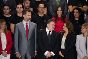Prince Felipe of Spain with  Carbures Europe President Carlos Guillen during a picture shot with Carbures Europe' employees on October 28, 2013 in Jerez de la Frontera, Spain.