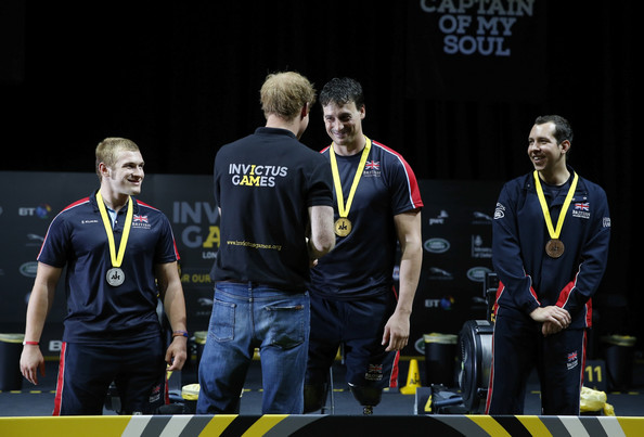 Prince Harry Nick Beighton of Great Britain is presented with his gold medal by Prince Harry after competing in the IV4 sprint indoor rowing at Olympic Park on September 13, 2014 in London, England. Photo: