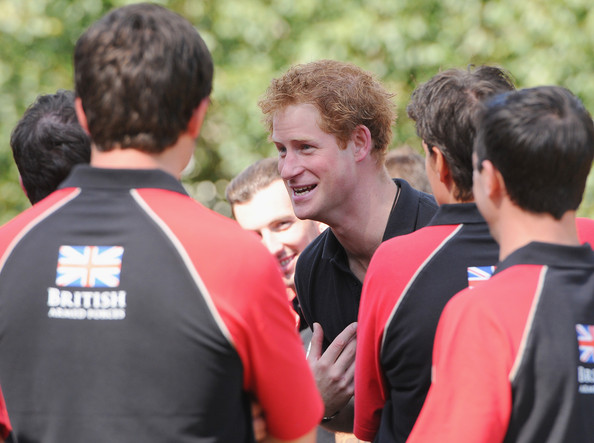 Prince Harry Prince Harry speaks with the British Armed Forces team during the British Armed Forces team announcement ahead of the Invictus Games at Potters Field Park on August 13, 2014 in London, England.
