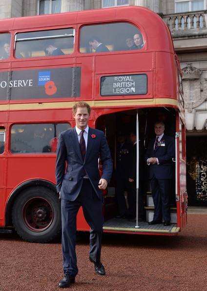 Prince Harry Prince Harry stands in front of the poppy bus after meeting supporters of the Royal British Legion's London Poppy Day appeal at Buckingham Palace on October 30, 2014 in London, England. The 1960s Routemaster bus today is carrying war veterans and celebrity supporters including Joss Stone and Barbara Windsor around London and will later meet the Prime Minister David Cameron.