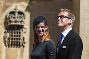 Actress Sarah Rafferty and her husband Santtu Seppala arrive at St George's Chapel at Windsor Castle for the wedding of Prince Harry and Meghan Markle on May 19, 2018 in Windsor, England.