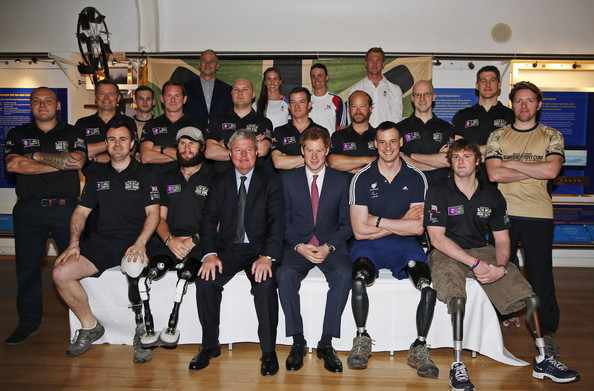 Britain's Prince Harry, centre, poses for pictures with members of the Row2Recovery 2011and 2013 crews at the River and Rowing Museum on March 10, 2014 in Henley on Thames, England. Prince Harry will met the Row to Recovery crew of wounded ex-servicemen who successfully rowed across the Atlantic in 2013. The Endeavour Fund, created by The Royal Foundation of The Duke and Duchess of Cambridge and Prince Harry, has supported Row to Recoverys legacy project to improve access to rowing facilities to aid recovery of wounded ex-servicemen and women.