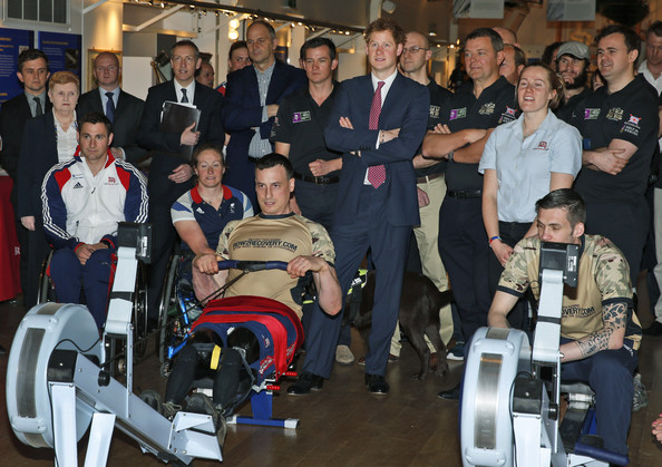 Britain's Prince Harry, centre, watches as members of the Row2Recovery crew compete in an indoor rowing race exhibition at the River and Rowing Museum on March 10, 2014 in Henley on Thames, England. Prince Harry will met the Row to Recovery crew of wounded ex-servicemen who successfully rowed across the Atlantic in 2013. The Endeavour Fund, created by The Royal Foundation of The Duke and Duchess of Cambridge and Prince Harry, has supported Row to Recoverys legacy project to improve access to rowing facilities to aid recovery of wounded ex-servicemen and women.