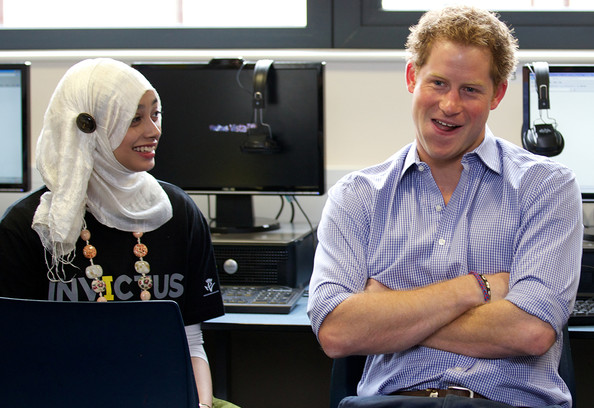 Prince Harry Prince Harry (R) is pictured during a visit to Bethnal Green Academy where he joined a group of 60 students from schools across east London who will be receiving training to become digital media champions for the Invictus Games on July 21, 2014 in London, England.  The Invictus Games is an international sports event for wounded warriors launched by Prince Harry which is coming to London from 10-14 September 2014.