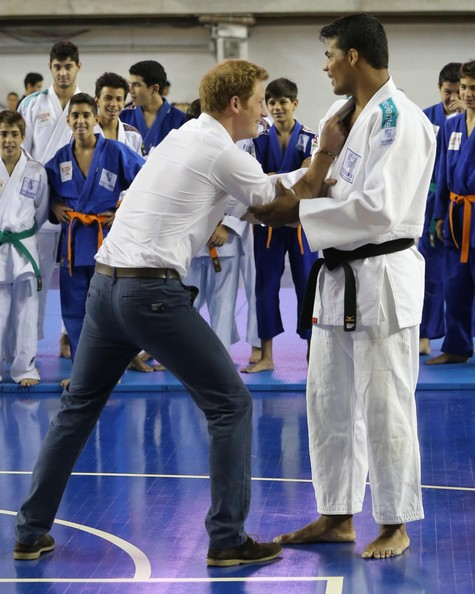 Prince Harry jokes with Judo athlete Luciano Correia during a visit to Minas Tenis Clube on the second day of his tour of Brazil on June 24, 2014 in Belo Horizonte, Brazil. Prince Harry is on a four day tour of Brazil that will be followed by two days in Chile.