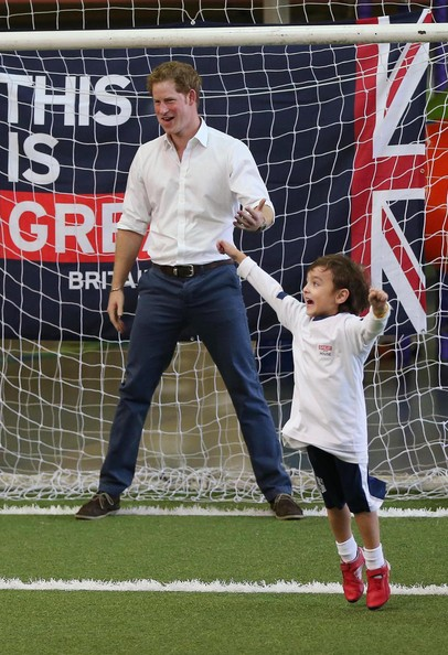 Retransmission of #451145448 with alternate crop.) A young boy celebrates after scoring a goal against Prince Harry during a visit to Minas Tenis Clube on the second day of his tour of Brazil on June 24, 2014 in Belo Horizonte, Brazil. Prince Harry is on a four day tour of Brazil that will be followed by two days in Chile.