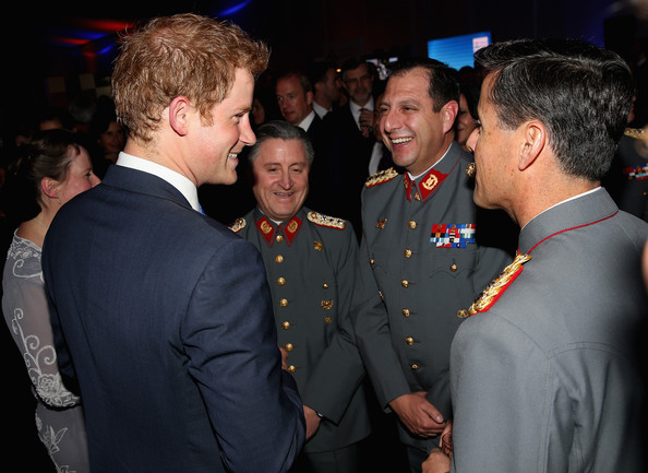 Prince Harry meets Chilean Military at a Queen's Birthday Party event at the British Ambassador's Residence on June 27, 2014 in Santiago, Chile.  Prince Harry is on a three day tour of Chile after visiting Brazil.