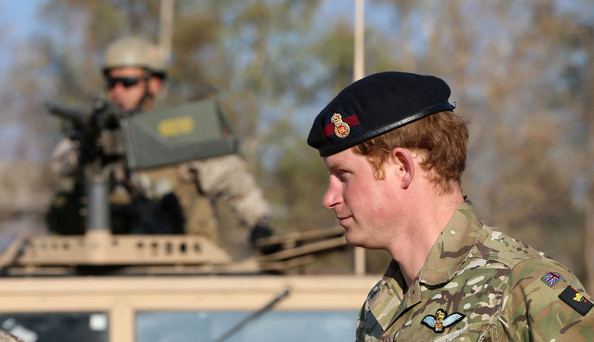 Prince Harry meets members of the Chilean Special Operations Brigade at Peldehue outside Santiago on June 27, 2014 in Santiago, Chile.  Prince Harry is on a three day tour of Chile after visiting Brazil.