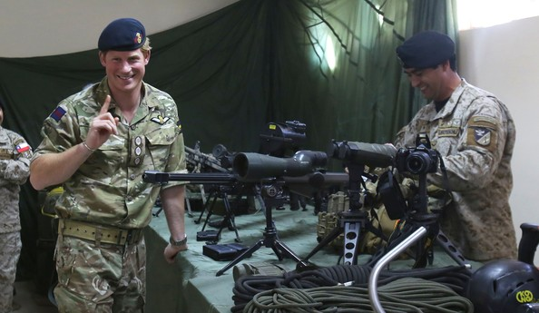 Prince Harry is shown a selection of sniper rifles as he met members of the  Chilean Special Operations Brigade at Peldehue outside Santiago on June 27, 2014 in Santiago, Chile.  Prince Harry is on a three day tour of Chile after visiting Brazil.