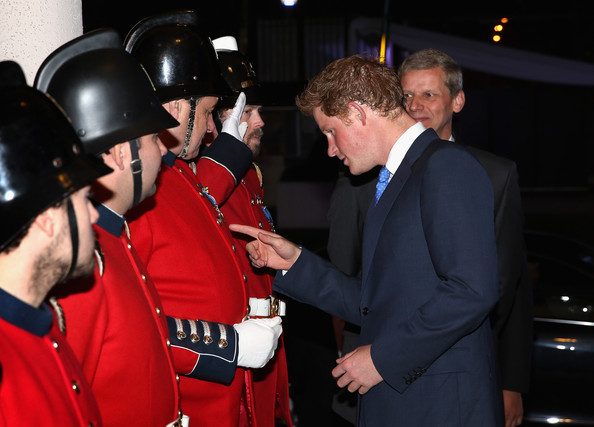 Prince Harry meets Chilean Firemen as he arrives at a Queen's Birthday Party event at the British Ambassador's Residence on June 27, 2014 in Santiago, Chile.  Prince Harry is on a three day tour of Chile after visiting Brazil.